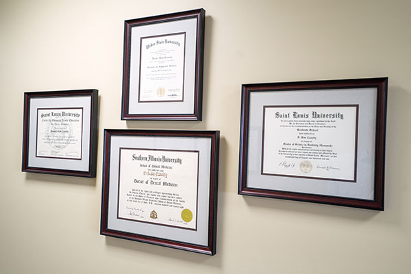 Framed doctor certifications at Cassity & Legacy Implants and Periodontics in South Ogden and Kaysville, UT
